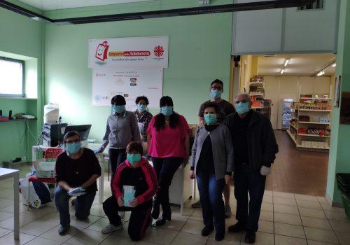 Caritas volontari emporio solidarietà