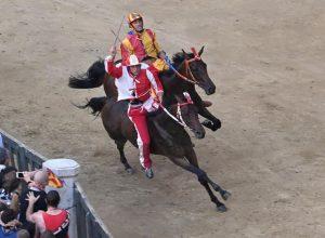 Horse Tale e Quale and his jockey Giovanni Atzeni, also known as Tittia from La Contrada della Giraffa competes to win the Palio di Siena, in Siena, Italy, 02 July 2019. The world famous horse race is dedicated to the Virgin Mary of Provenzano. ANSA/CLAUDIO GIOVANNINI