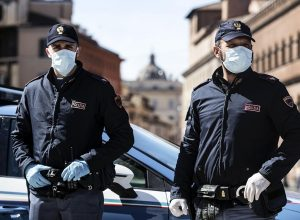 Italian police officers wearing protective masks out checks on motorists and pedestrians due to the Coronavirus emergency  in Rome, Italy, 12 March 2020. Tough lockdown measures kicked in throughout Italy on 12 March after Prime Minister Giuseppe Conte announced late on 11 March that all non-essential shops should close as part of the efforts to contain the ongoing pandemic of the COVID-19 disease caused by the SARS-CoV-2 coronavirus. ANSA/ANGELO CARCONI